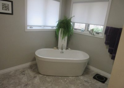 Large White Bath Tub with Silver Accents