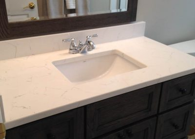 White Marble and Brown Vanity