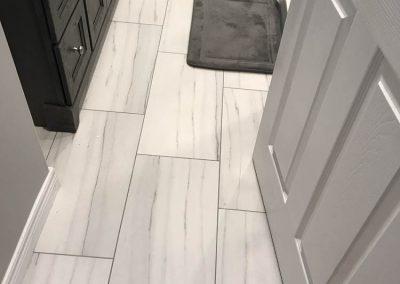 Marble Floor with Black Vanity