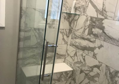 Marble Shower with Glass Doors