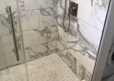 Marble Shower with Patterned Floor