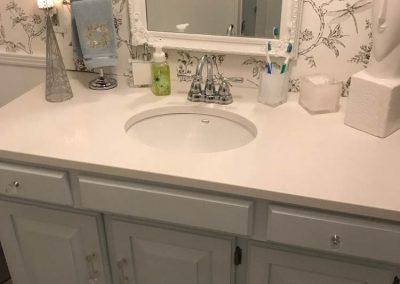 White Sink with Blue Vanity