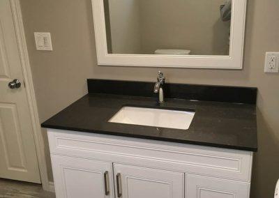 Black Sink with White Vanity