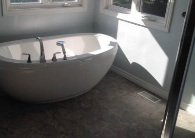 White Bathtub with Silver Accents