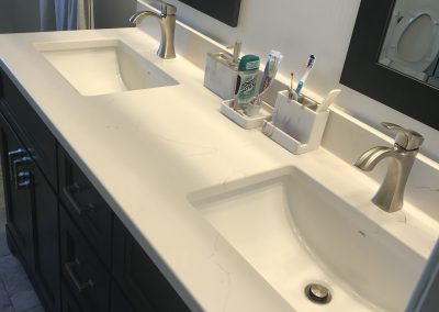 White Sink with Black Vanity