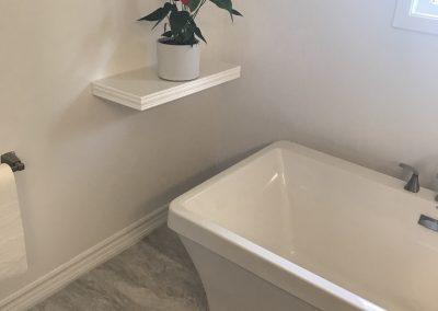 White Bathtub and Shelf