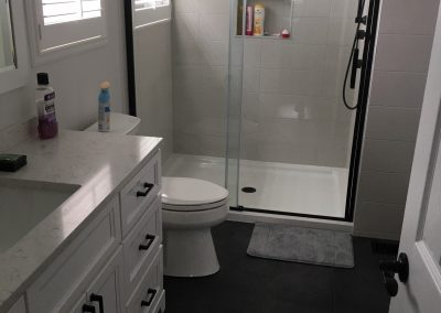 Black Tile with White Shower