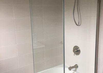 white-bathtub-glass-shower-door